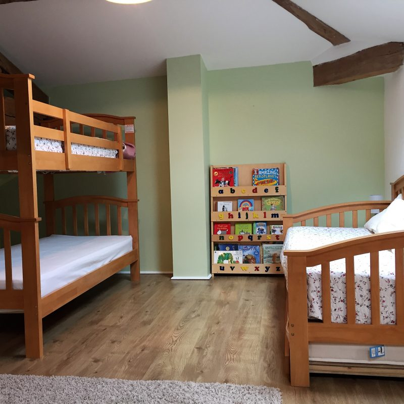 Family room - air conditioned large room with double, bunk, single beds and a full size cot